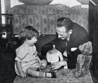 A. A. Milne and Christopher Robin A. A. Milne and Christopher Robin Milne - playing with a toy teddy bear. CRM, son of A. A. Milne, basis of the character Christopher Robin in A. A. Milne's Winnie-the-Pooh:: 21 August 1920 – 20 April 1996. AAM, English author: 18 January 1882 – 31 January 1956. (Photo by Culture Club/Getty Images)